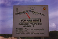 A sign showing the location of emergency telephones