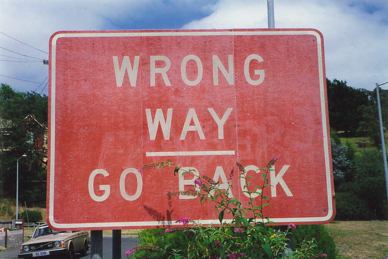 A road sign saying 'Wrong Way – Go Back'