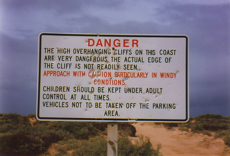 A sign warning of the Nullarbor's dangerous cliffs
