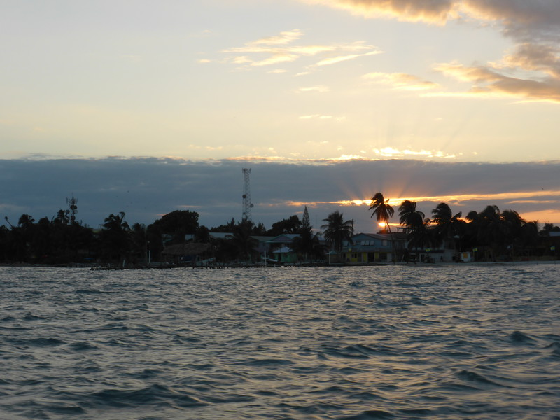 Sunset over Caye Caulker on our way home