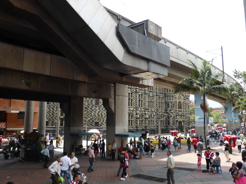 The Metro cuts right through the centre of the city; here, you can just about see the chequerboard of the Palacio de la Cultura Rafael Uribe Uribe on the other side