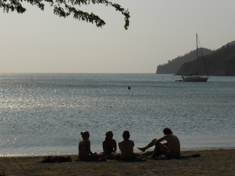 People relaxing on the beach in Taganga