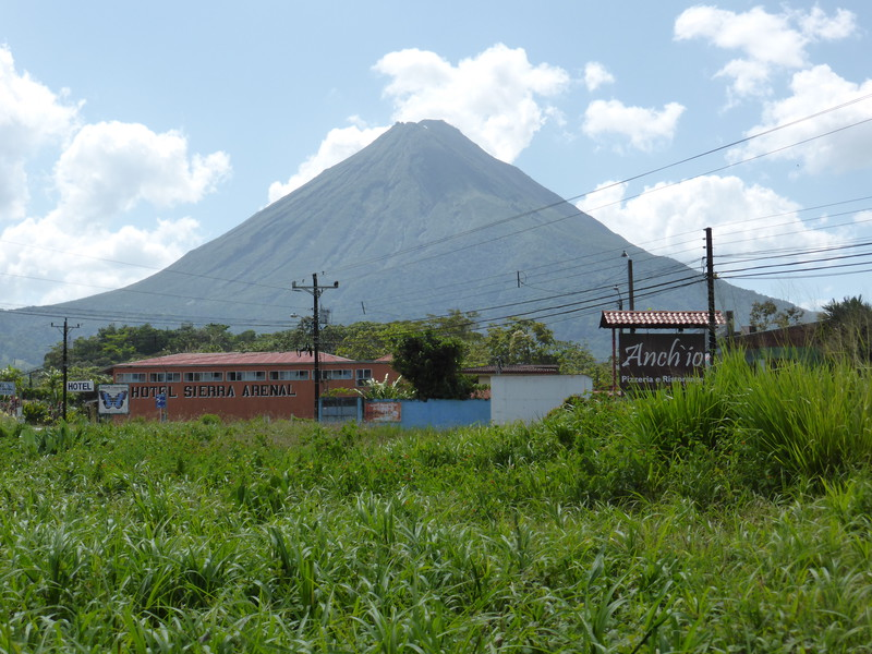 The perfect cone of Volcán Arenal towers over La Fortuna