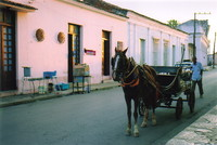 A horse and cart in a street in Remedios