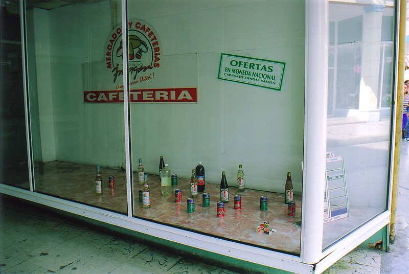 A window display in a Cuban peso shop