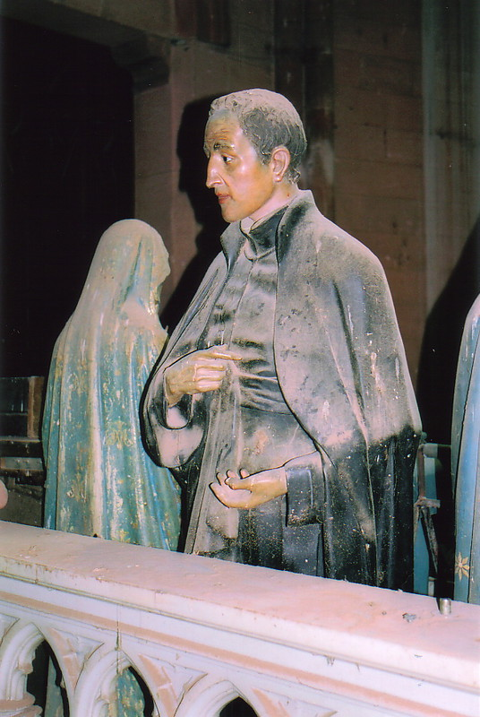 A dust-covered statue inside the church of El Sagrado Corazón de Jesus