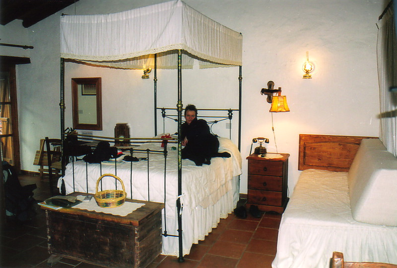 Peta on a four-poster bed in the Linos Inn
