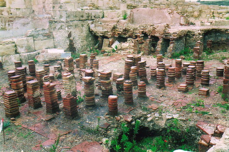 Columns of bricks from an under-floor heating system