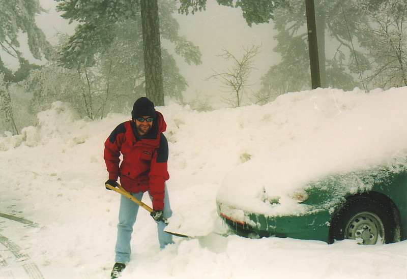 Mark digging a car out of a snowdrift