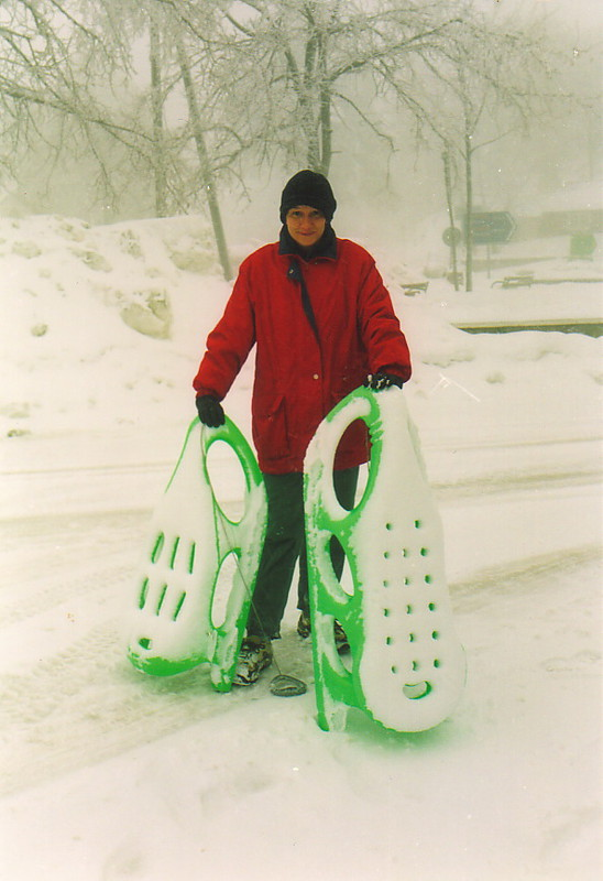 Peta holding two sledges