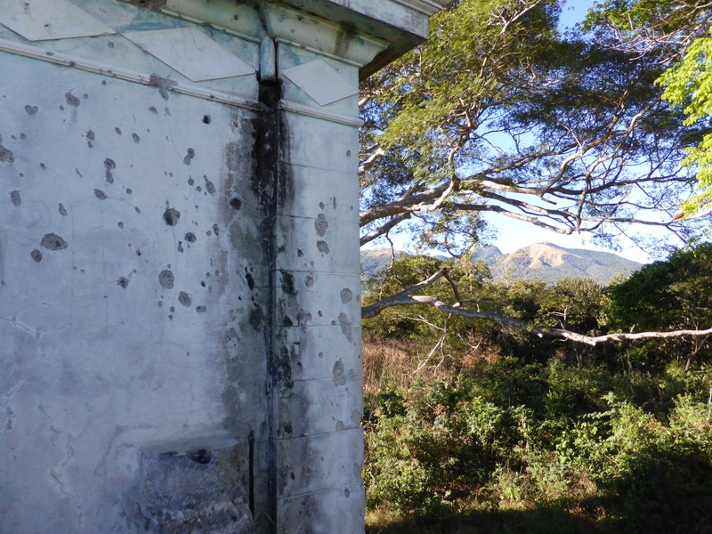 Bullet holes sprayed across the walls of the ex-presidential house