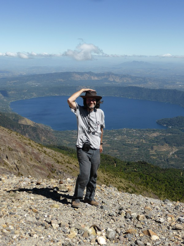 Mark on the top of Santa Ana, with Lago de Coatepeque in the background