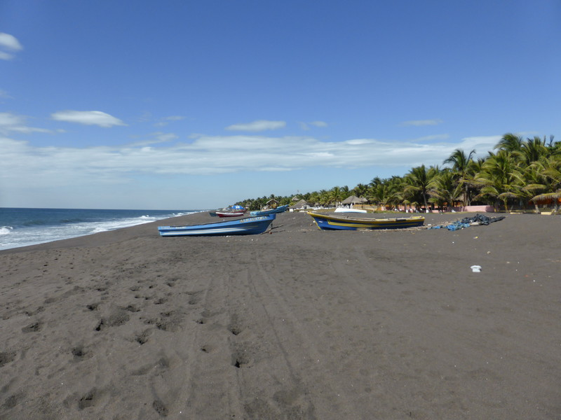Looking north along the black sands of Monterrico beach