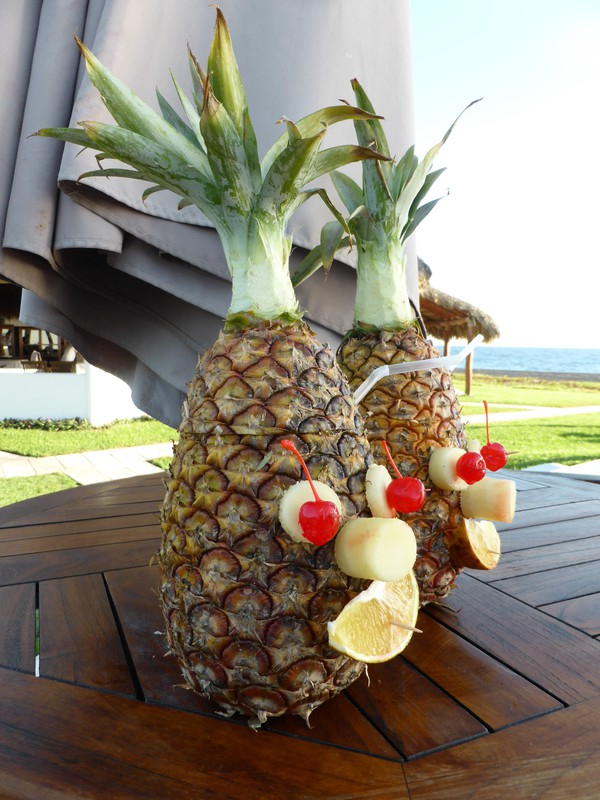 The piña coladas at Dos Mundos are served in cheerful pineapples