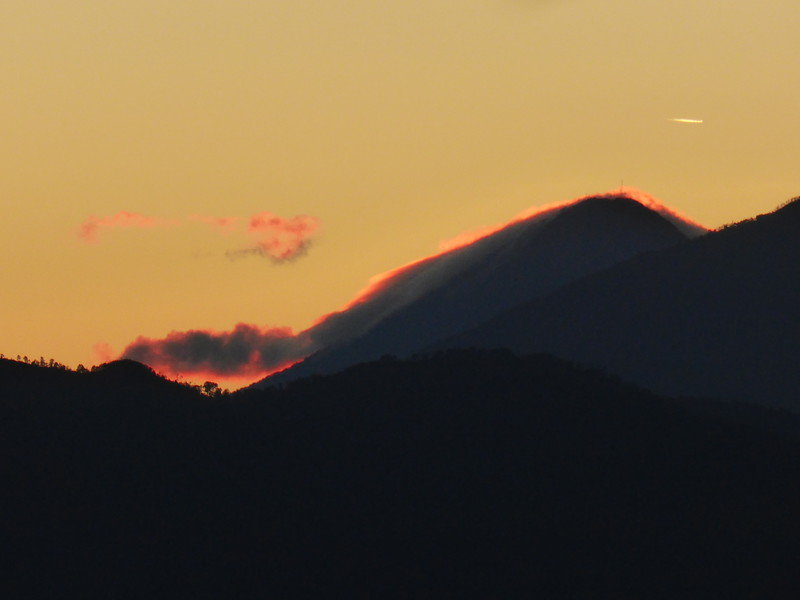 The sun rising behind Volcán Agua and Actenango