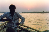 A man rowing a boat on the Ganges at dawn