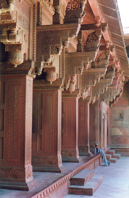 Intricate red carved pillars at Agra Fort