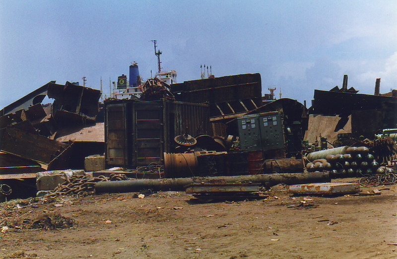 Piles of ship parts in the yards of Alang