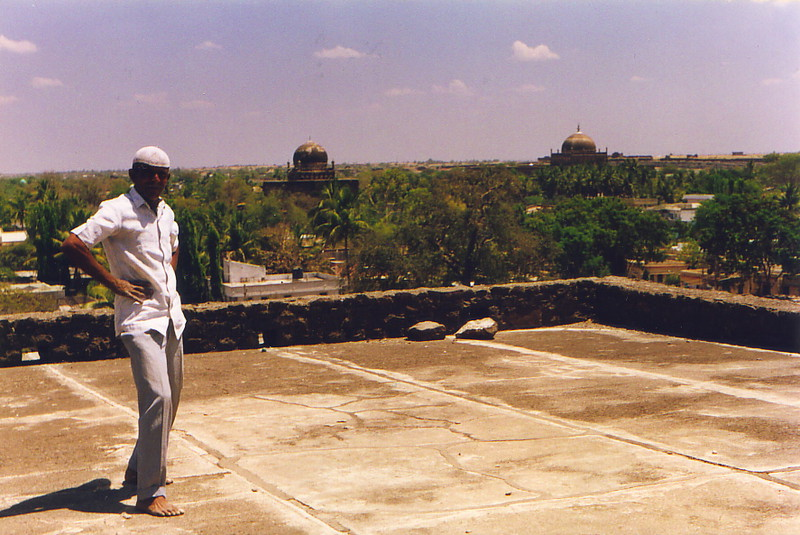 A man on a roof in Bijapur