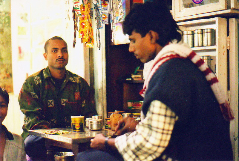 A man buying pan from the pan-wallah