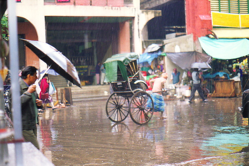 A hand-pulled rickshaw in the rain