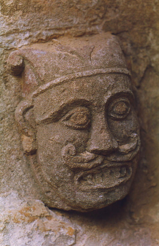 A carving of a man's grimacing face