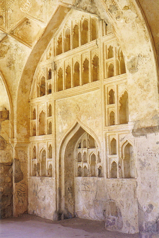 Carved alcoves set into a wall in Golconda