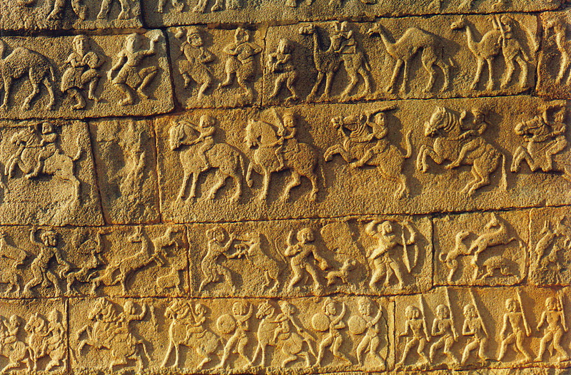 A carved relief on a wall in Hampi