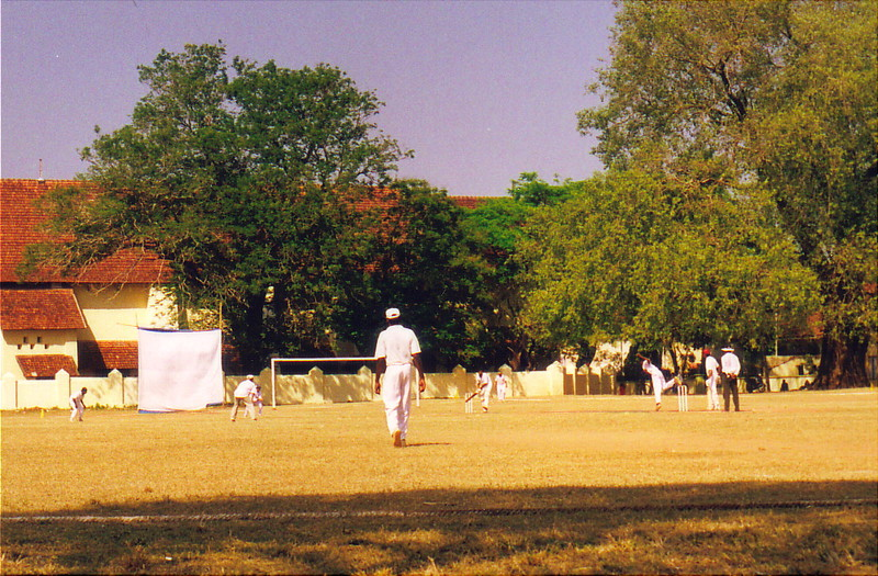 Sunday cricket on the green in front of St Francis' Church