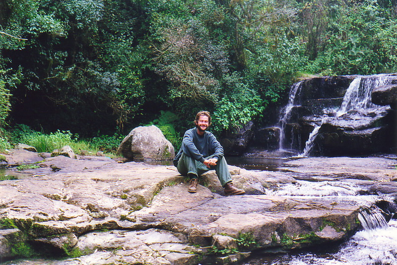 Mark sitting by a waterfall