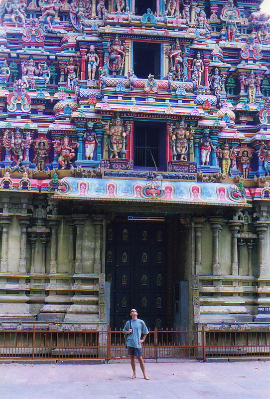 Howard standing beneath a large gopuram in Madurai
