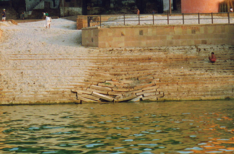 A collapsing ghat by the Ganges
