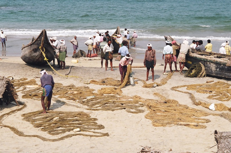 Fishermen laying out their nets to dry on Hawah Beach