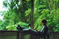 Mark eading a book on the veranda at Kuala Perkai