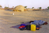 A camp on the sand by a Tuareg tent