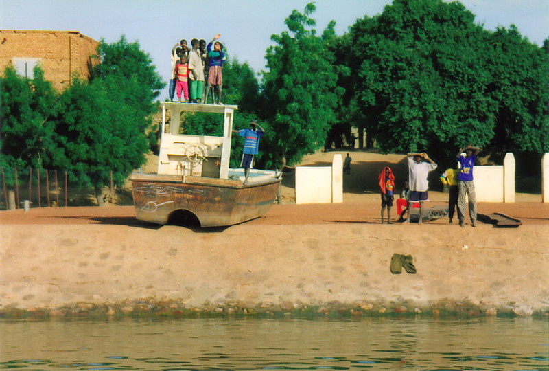 A beached fishing trawler on the banks of the River Niger