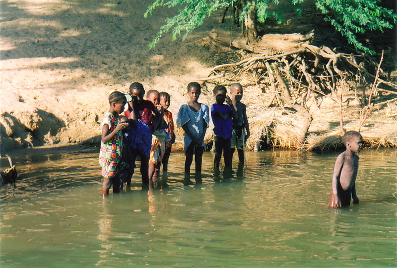 Children standing in the River Niger