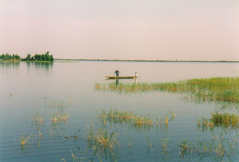 A fisherman in a boat on the River Niger near Tonka