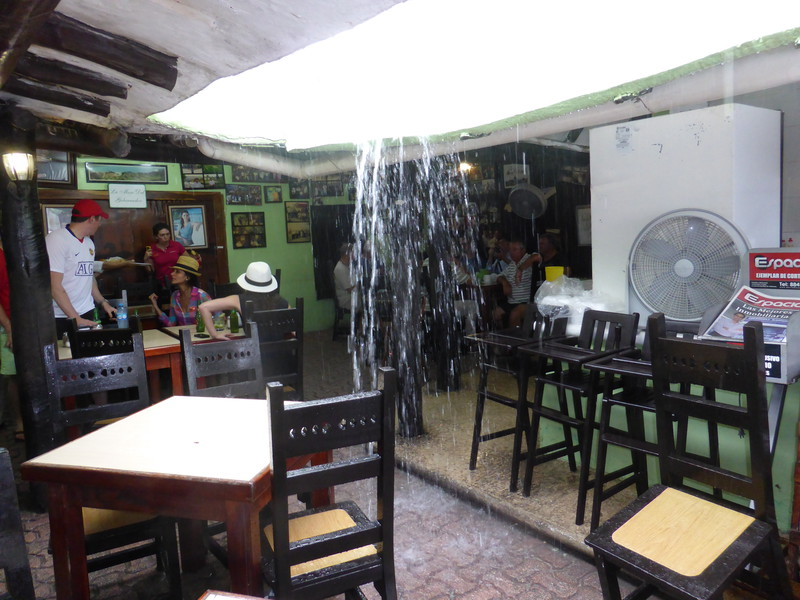 Rain in Tulum pouring through a restaurant roof