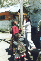 Chidren in Braga examining a camera