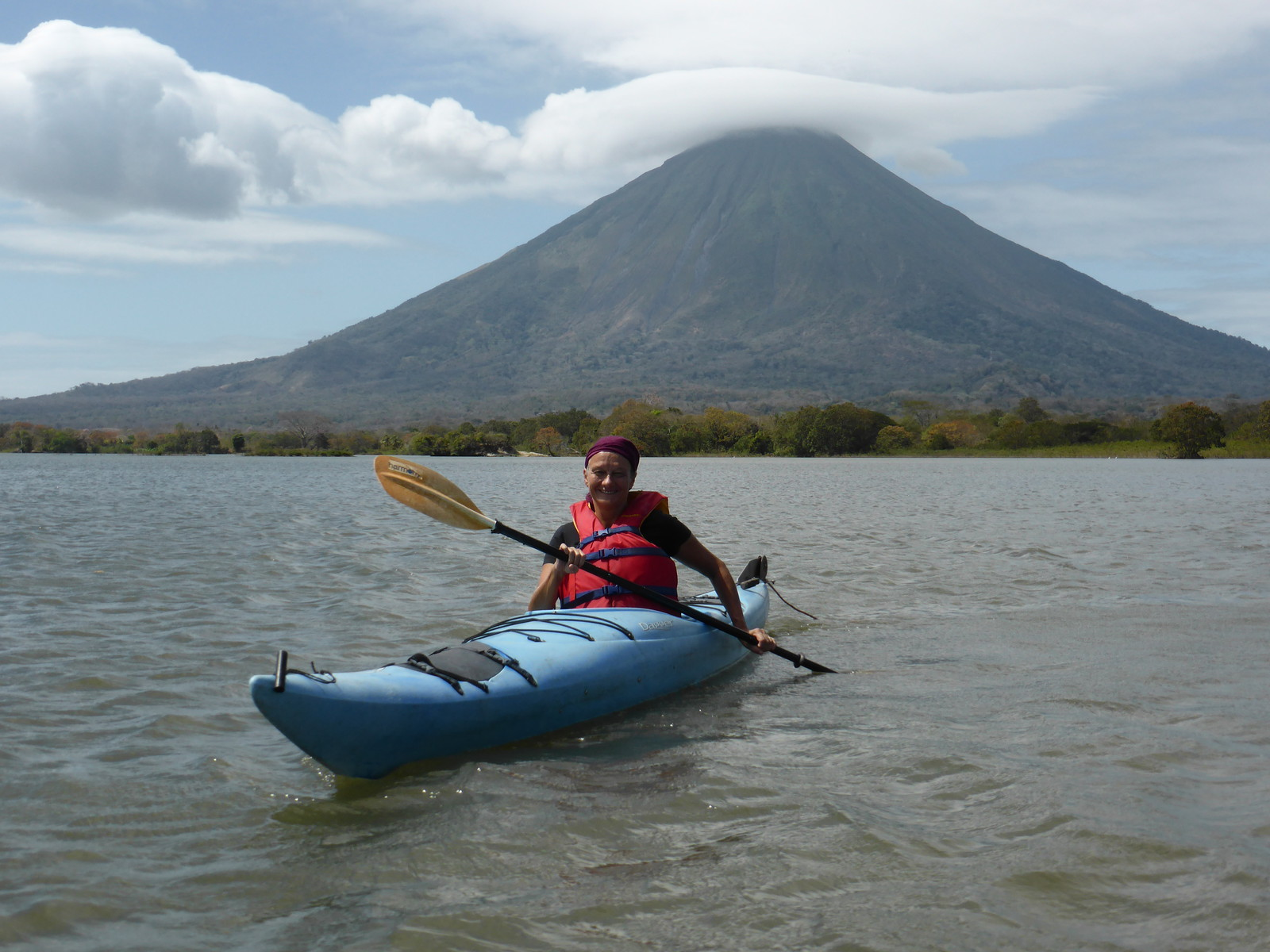 Peta kayaking off Ometepe with Volcán Concepción in the background