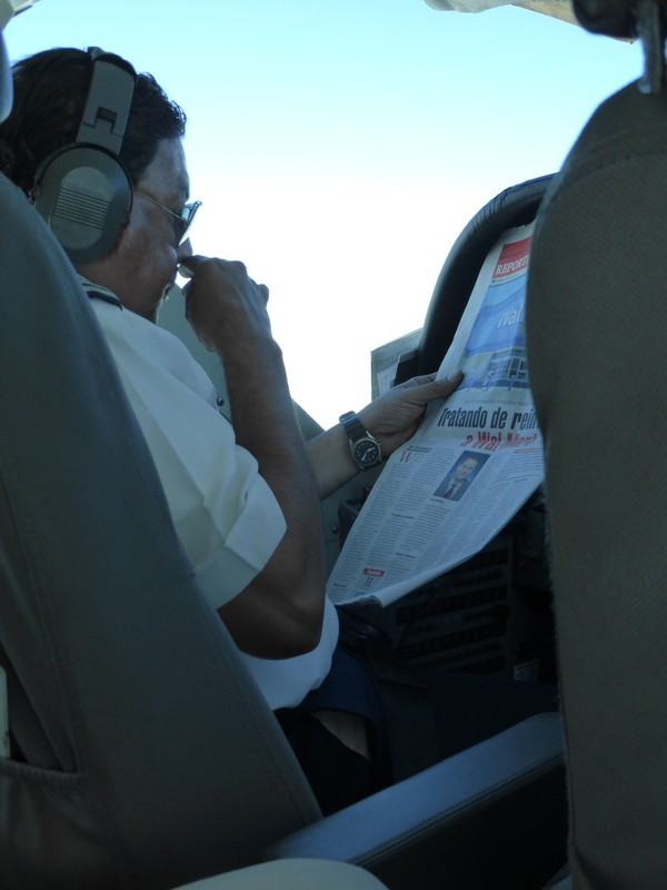 The pilot catching up on the news, mid-flight