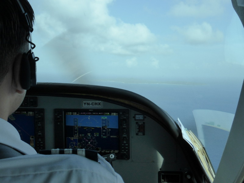 The co-pilot's view of Corn Island as it appears on the horizon