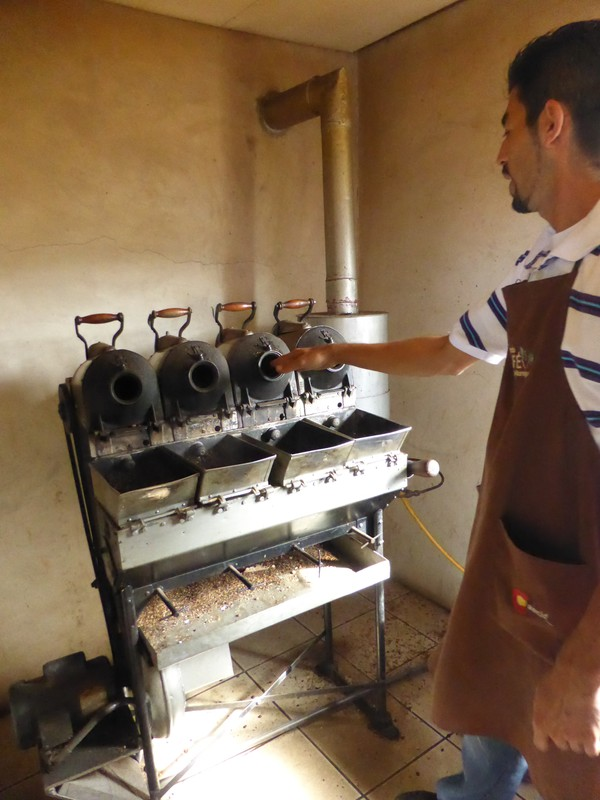 Alexander roasting samples of coffee beans
