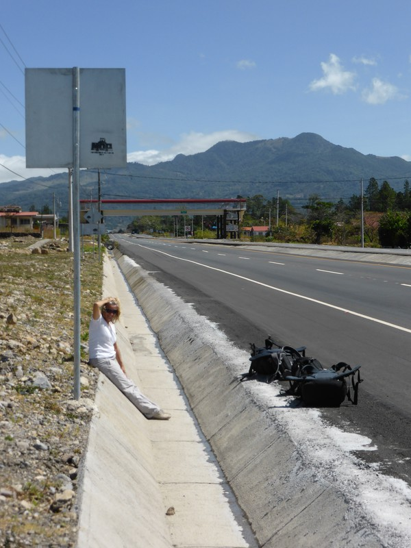 Peta sitting by the road in Boquete as we waited for the bus to David and on to Santiago
