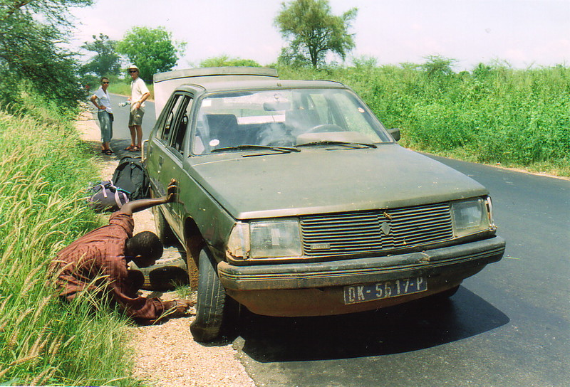 A Senegalese taxi broken down by the side of the road