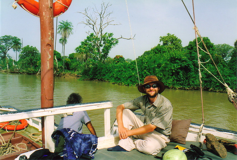 Mark relaxing on a boat on the River Gambia