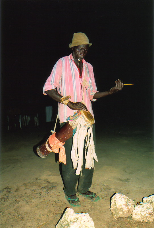 A Gambian musician playing the drums