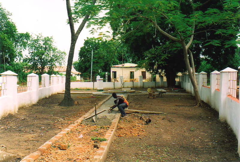 A man laying concrete at the Freedom Monument